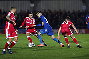 AFC Wimbledon striker Joe Pigott (39) takes on Gillingham attacker (Tom) Thomas O Connor (24) and dribbling during the EFL Sky Bet League 1 match between AFC Wimbledon and Gillingham at the Cherry Red Records Stadium, Kingston, England on 23 November 2019.