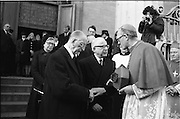 Funeral of Sinead Bean DeValera.    (H82)..1975..09.01.1975..01.09.1975..9th January 1975..Today saw the funeral of Sinead Bean DeValera take place at the Pro Cathedral, Dublin. She was the wife of Ex-President Eamon DeValera. Mrs Devalera was a noted author of childrens literature..Mrs DeValera, Born 3rd June 1878. Died 7th Jan 1975...Picture of Eamon DeValera being consoled by the Archbishop of Dublin,Dr Ryan on the death of his wife Sinead...Image of family and friends of the late Sinead Bean DeValera as they leave the Pro-Cathedral on their way to Glasnevin Cemetery.
