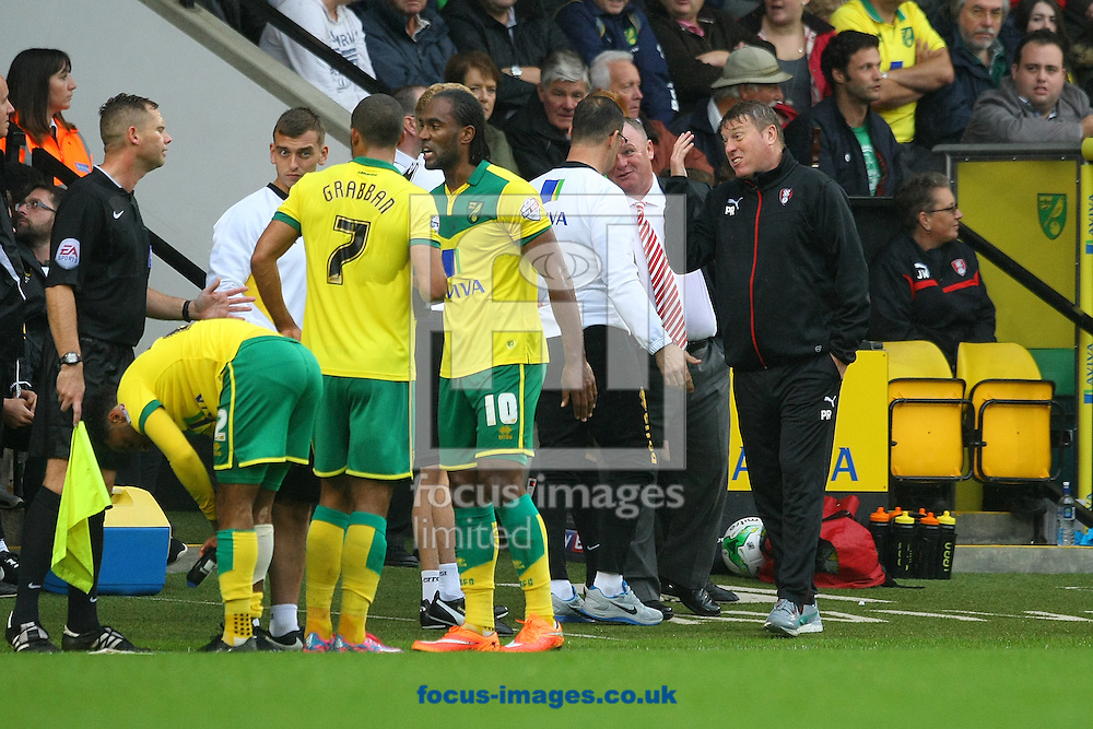 Tempers flare on the touchline as Norwich Goalkeeping Coach Tony Parks gets involved in an argument with Rotherham United Manager Steve Evans and his Assistant Manager Paul Raynor during the Sky Bet Championship match at Carrow Road, Norwich<br /> Picture by Paul Chesterton/Focus Images Ltd +44 7904 640267<br /> 04/10/2014