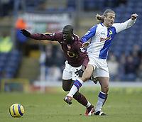 Photo: Aidan Ellis.<br /> Blackburn Rovers v Arsenal. The Barclays Premiership. 25/02/2006.<br /> Blackburn's Tugay challenges Arsenal's Abou Diaby