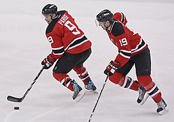 Jan 29, 2010; Newark, NJ, USA; New Jersey Devils left wing Zach Parise (9) skates up ice with New Jersey Devils center Travis Zajac (19) during the third period of their game against the Toronto Maple Leafs at the Prudential Center. The Devils won 5-4 in overtime.