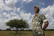 Nkwe wildlife security services offer a paramilitary - style rhino protection service that operates in the several private game reserves in the Limpopo area of South Africa..Nkwe's recruits undergo a basic two week training program focusing on military discipline and endurance to become a field ranger. From this stage the field rangers may be selected for an advance course that focuses on firearms and tactical training. Once this is completed they will be given rank and go on armed patrol to protect the rhinos...Pic shows: Field ranger Patrick (as requested No surname) completes his basic training and looks forward to the advance training in order to protect the rhino...Nkwe Wildlife Security Services based in the Lapalala Wilderness Area, Limpopo, South Africa...© Zute Lightfoot