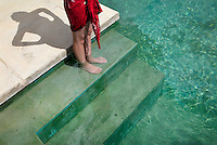 a woman stands on the top step of the pool at Hix Island House in Vieques, Puerto Rico