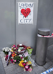© Licensed to London News Pictures. 05/06/2017. London, UK. Flowers an a hand made poster saying 'LONDON I LOVE MY CITY' are seen near London Bridge following a terrorist attack on Saturday evening. Three men attacked members of the public  after a white van rammed pedestrians on London Bridge.   Ten people including the three suspected attackers were killed and 48 injured in the attack. Photo credit: Peter Macdiarmid/LNP