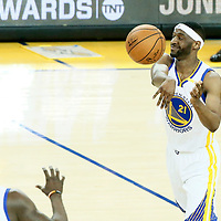01 June 2017: Golden State Warriors guard Ian Clark (21) passes the ball to Golden State Warriors forward Draymond Green (23) during the Golden State Warriors 113-90 victory over the Cleveland Cavaliers, in game 1 of the 2017 NBA Finals, at the Oracle Arena, Oakland, California, USA.
