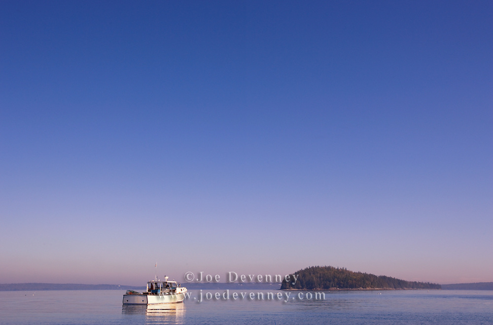 Lobster boat on its mooring on a still afternoon. Sorrento, Maine