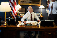 WASHINGTON, DC - APRIL 3:  Vice President Joe Biden discusses options with his staff, Steve Ricchetti, during a  meeting in his office at the White House on Wednesday April 3, 2013. (Photo by Melina Mara/The Washington Post)