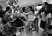 Awilda Vasquez is welcomed by her family and friends at Newark Airport as she returns from Iraq.