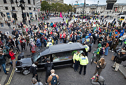 © Licensed to London News Pictures. 07/10/2019. London, UK. Extinction Rebellion activists blockade Trafalgar Square, central London with a hearse. Activists are converging on Westminster blockading roads in the area for at least two weeks calling on government departments to 'Tell the Truth' about what they are doing to tackle the Emergency. Photo credit: Peter Macdiarmid/LNP