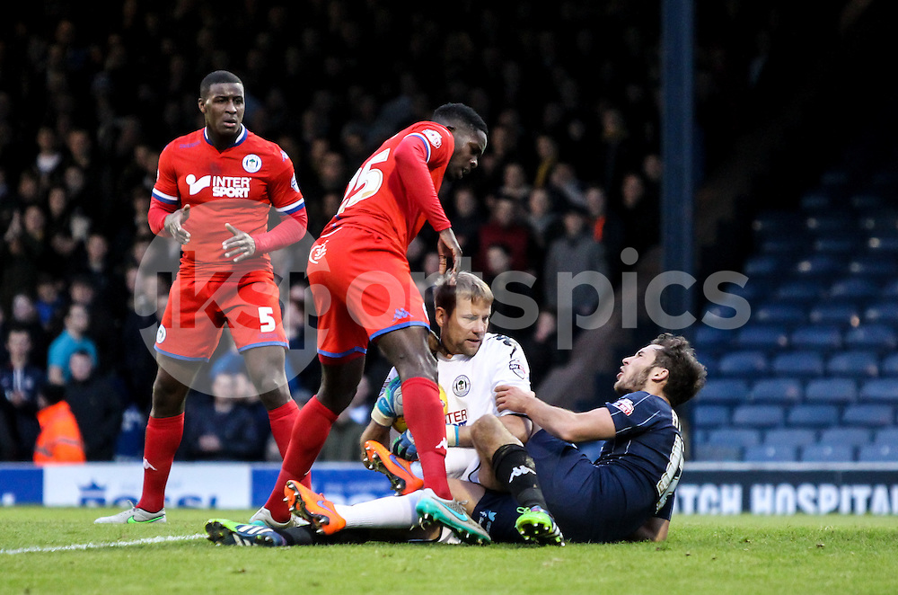 Jussi Jääskeläinen  of Wigan Athletic and Will Atkinson of Southend United tussle during the Sky Bet League 1 match between Southend United and Wigan Athletic at Roots Hall, Southend, England on the 28th November 2015. Photo by Ken Sparks.