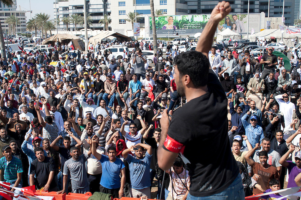 © under license to London News Pictures. 20/02/2011. A man leads the crowd in chants at against the Prime Minister at Pearl Roundabout in Manama, Bahrain.
