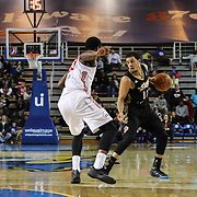 Erie BayHawks Guard Seth Curry (12) attempts to past the ball as Delaware 87ers Forward Victor Rudd (23) defends in the second half of a NBA D-league regular season basketball game between the Delaware 87ers and the Erie BayHawk (Orlando magic) Friday, Jan. 02, 2015 at The Bob Carpenter Sports Convocation Center in Newark, DEL