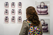 Parfums De Revolte by Hayat. The Affordable Art Fair opens in Battersea and runs until 26 October. Here viewing the work of   . This is the15th anniversary fair and includes a Recent Graduates' Exhibition and a specially commissioned comedy, The Complete History of Art (abridged) courtesy of the Reduced Shakespeare Company.  The fair offers visitors a chance to purchase work from over 100 galleries at prices between £40 and £4,000. Battersea Park, London UK 22 Oct 2014. Guy Bell, 07771 786236, guy@gbphotos.com