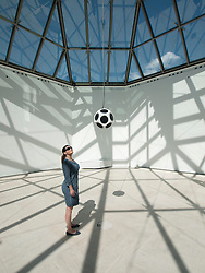 woman looking at sound installation at Modern Art Museum MUDAM Musee d'Art Moderne Grand Duc Jean  Luxembourg