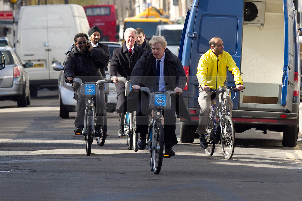 © Licensed to London News Pictures. 08/03/2012. London, UK. Mayor of London Boris Johnson pictured cycling towards the Roman Road Market today (08/03) to publicise the eastern extension of the Barclays Bike cycle hire scheme which launches today. Photo credit : James Gourley/LNP