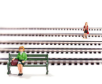 Women waiting for train on white background