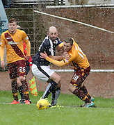 Dundee&rsquo;s Gary Harkins and Motherwell&rsquo;s Josh Law battle for the ball in blizzard conditions - Dundee v Motherwell, Ladbrokes Premiership at Dens Park <br /> <br />  - &copy; David Young - www.davidyoungphoto.co.uk - email: davidyoungphoto@gmail.com