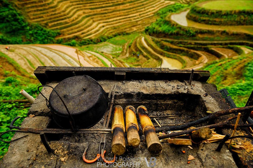 Preparation of the famous bamboo chicken, Tiantouzhai village, Dragon's backbone Rice terraces, China