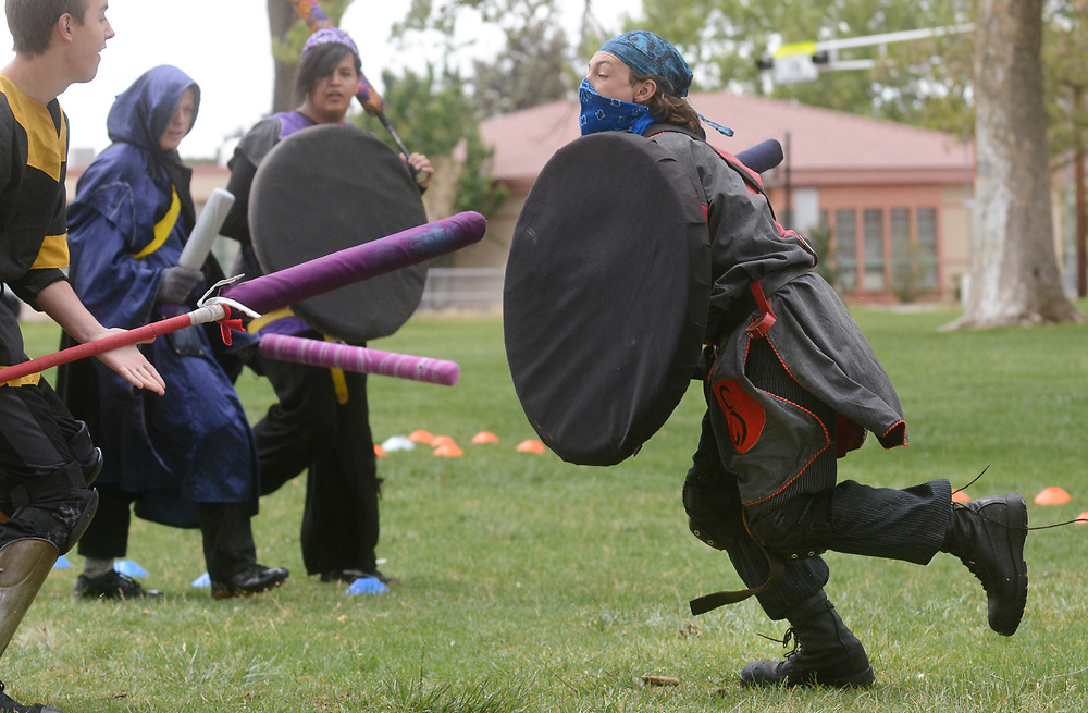mkb042917l/metro/Marla Brose -- Kadin Heyser, right, a live action role player (LARP), charges during a fighting game in Taylor Park, Saturday, April 29, 2017, in Albuquerque, N.M. (Marla Brose/Albuquerque Journal)