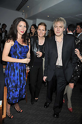 Left to right, CHLOE BAIRD-MURRAY, AMANDA KYME and NICK RHODES at a dinner hosted by Ruinart Champagne for Yasmin Mills at Nobu, Park Lane, London on rth May 2009.