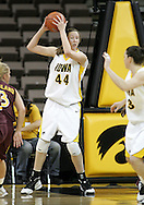 25 JANUARY 2007: Iowa center Megan Skouby (44) looks for an open player after grabbing a rebound in Iowa's 80-78 overtime loss to Minnesota at Carver-Hawkeye Arena in Iowa City, Iowa on January 25, 2007.