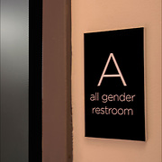All Gender Restroom sign next to door to restroom.<br />