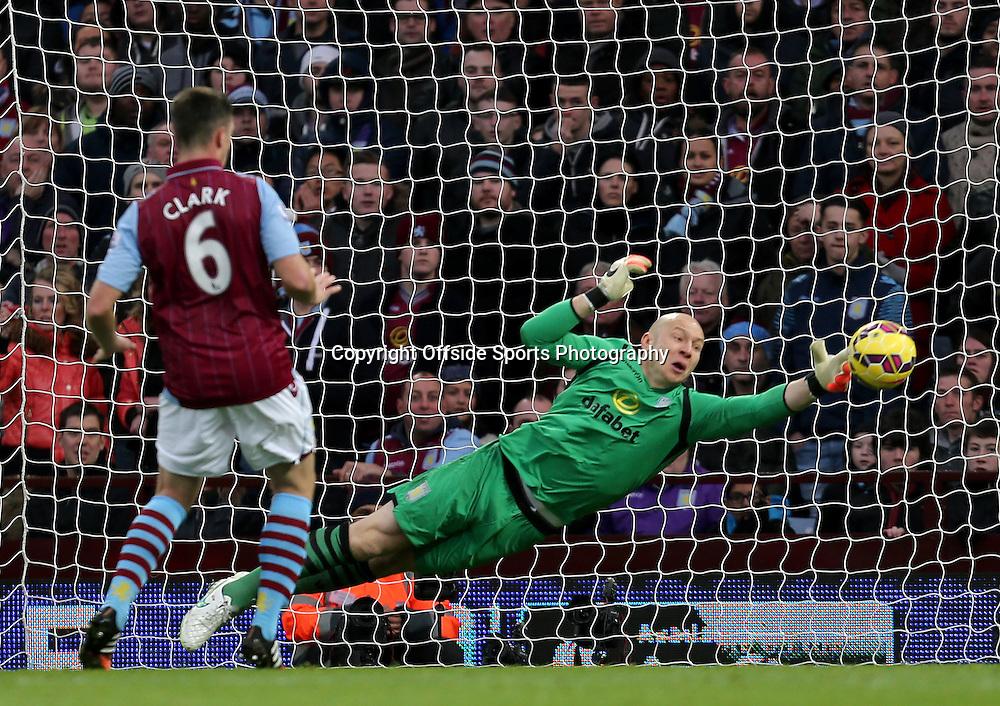 20th December 2014 - Barclays Premier League - Aston Villa v Manchester United - Aston Villa keeper Brad Guzan saves from a Wayne Rooney shot - Photo: Paul Roberts / Offside.
