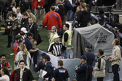 Feb 6, 2011; Arlington, TX, USA; NFL referee Walt Anderson (66) tests instant replay equipement before Super Bowl XLV between the Green Bay Packers and the Pittsburgh Steelers at Cowboys Stadium.