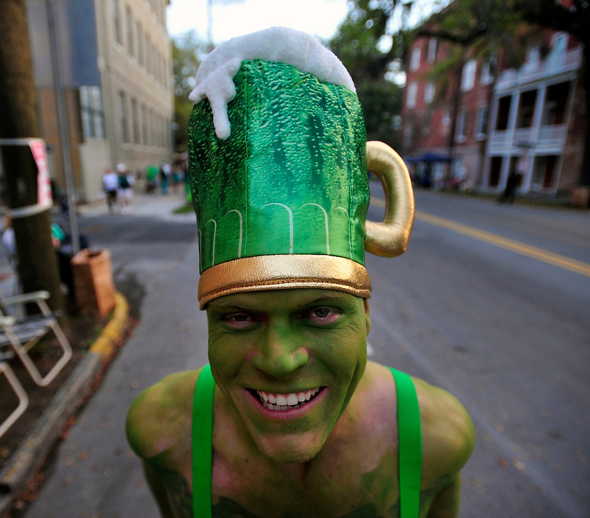 Getting into the spirit of St. Patrick's Day with a giant beer mug for a hat, Lynn Davis of Woodbridge, New Jersey waits for the Savannah St. Patrick's Day parade to start. Savannah plays host to hundreds of thousands of visitors from around the world for the annual parade.