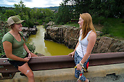 Fort Lewis College students Sierra Jeffers and McKenzie Purdue stop at Baker's Bridge to observe the discoloration of the Animas River. Jeffers (left) works at a local rafting company as a river guide, one of the many tourism industries directly affected by this environmental disaster.