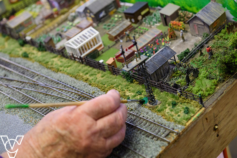 INSIGHT MAGAZINE: Bridlington Model Railway Society are based in Station Road, Bridlington, in a railway arch unit owned by Network Rail.  Pictured is Trevor Pritchard working on the model of Filey station.<br /> <br /> Picture: Chris Vaughan Photography<br /> Date: May 31, 2017