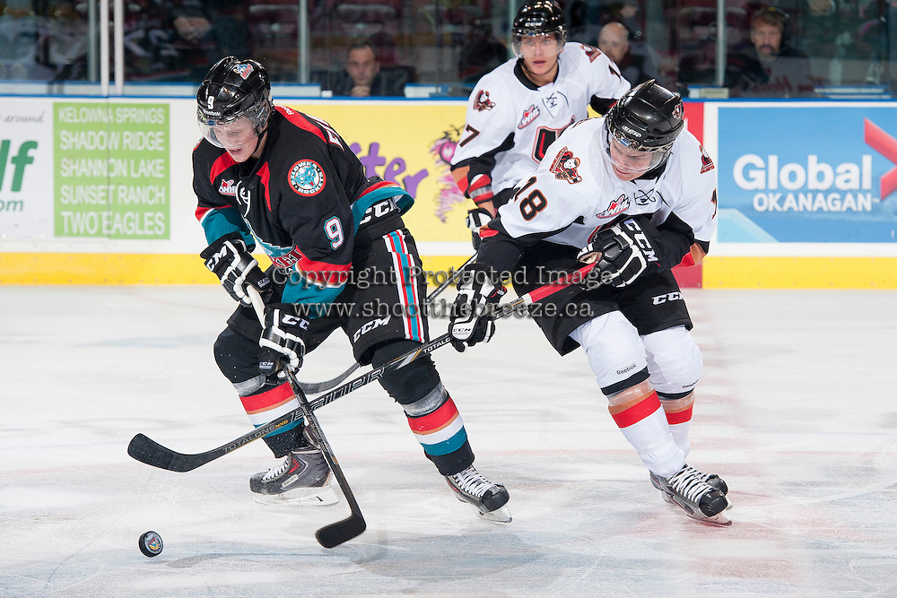 KELOWNA, CANADA - OCTOBER 22:  Zach Franko #9 of the Kelowna Rockets is checked by Jake Virtanen #18 of the Calgary HItmen on October 22, 2013 at Prospera Place in Kelowna, British Columbia, Canada.   (Photo by Marissa Baecker/Shoot the Breeze)  ***  Local Caption  ***