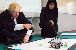 Camden City Learning Centre, London, June 15th 2015. London Mayor Boris Johnson joins future entrepreneurs at Camden City Learning Centre to launch London Technology Week and to launch a dedicated online hub for the Capital's thriving technology industry. PICTURED: Boris Johnson watches a robot as it detects colour patches.