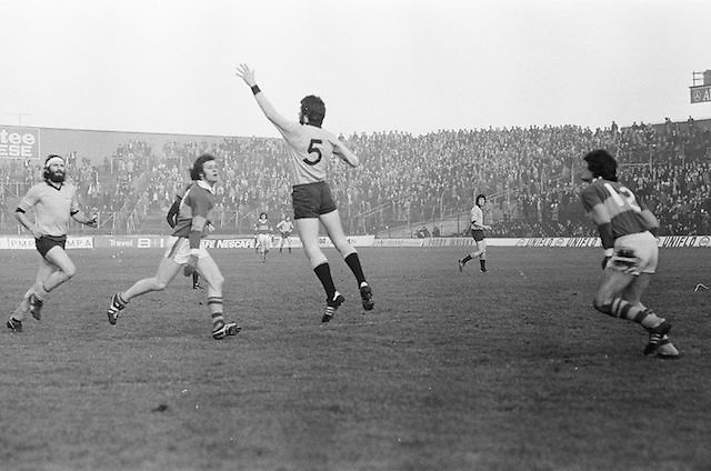 Dublin jumps waiting for the ball to come towards him during the All Ireland Senior Gaelic Football Semi Final, Dublin v Kerry in Croke Park on the 23rd of January 1977. Dublin 3-12 Kerry 1-13.
