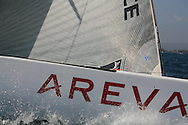 France's Areva Challenge splashes through waves before start of America's Cup fleet racing; Valencia, Spain.