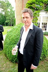 HUGH GRANT at the Raisa Gorbachev Foundation Party held at Stud House, Hampton Court Palace on 5th June 2010.  The night is in aid of the Raisa Gorbachev Foundation, an international fund fighting child cancer.