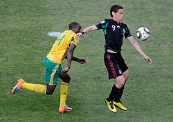 11.06.2010, Soccer City Stadium, Johannesburg, RSA, FIFA WM 2010, Südafrika vs Mexico im Bild Aaron Mokoena (South Africa) e Guillermo Franco (Mexico), EXPA Pictures © 2010, PhotoCredit: EXPA/ InsideFoto/ G. Perottino, ATTENTION! FOR AUSTRIA AND SLOVENIA ONLY!!! / SPORTIDA PHOTO AGENCY