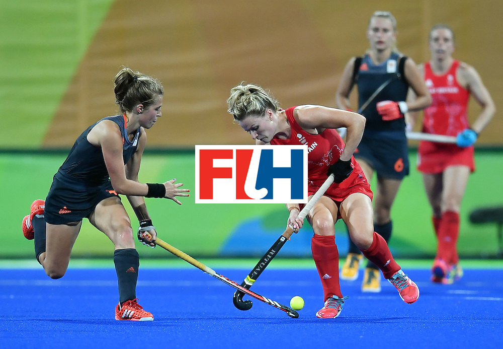 Netherlands' Xan de Waard (L) vies with Britain's Hollie Webb (2nd L) during the women's Gold medal hockey Netherlands vs Britain match of the Rio 2016 Olympics Games at the Olympic Hockey Centre in Rio de Janeiro on August 19, 2016. / AFP / MANAN VATSYAYANA        (Photo credit should read MANAN VATSYAYANA/AFP/Getty Images)