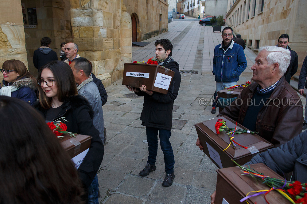 14/04/2018. Relatives and supporters hold coffins containing the bodies of victims of Spain Civil War during a homage to hand the remains to their families on April 14, 2018 in Soria, Spain. La Asociacion Soriana Recuerdo y Dignidad (ASRD) 'The Soria Association for Memory and Dignity' celebrated a tribute to hand over the remains of civil war victims to their families. The Society of Sciences of ARANZADI helped with the research, exhumation and identification of the bodies, after villagers passed the information about the mass grave, 81 years after the assassination took place, to the ASRD. Seven people were assassinated around August 25, 1936 by Falangists, as part of General Francisco Franco armed forces, and buried in the 'Fosa de los Maestros' (Teachers Mass Grave) near Cobertelada, Soria, after being taken from prison of Almazan during the Spanish Civil War. Five of them were teachers in the region, and also friends of Spanish writer Antonio Machado. The other two still remain unidentified. Another body was assassinated by Falangists accompanied by a priest in 1936, and was exhumed on 23 September of 2017 near Calata&ntilde;azor, Soria. It belonged to Abundio Andaluz, a politician, lawyer and musician in Soria.<br /> Spain's Civil War took the lives of thousands of people on both sides, and civilians. But Franco continued his executions after the war has finished. Teachers, as part of the education sector, were often a target of Franco's forces. Spanish governments has never done anything to help the victims of the Civil War and Franco's dictatorship while there are still thousands of people missing in mass graves around the country. (&copy; Pablo Blazquez)