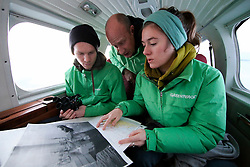 NORWAY BARENTS SEA 6DEC15 - Greenpeace campaigners Larissa Baeumer, Christian Bussau of Germany and Erlend Tellnes (L) of Norway study charts during the survey flight to the production platform Goliat in the Barents Sea operated by Italian energy compay Eni. It is the world's most northerly oil production platform.<br /> <br /> jre/Photo by Jiri Rezac / Greenpeace<br /> <br /> © Jiri Rezac 2015