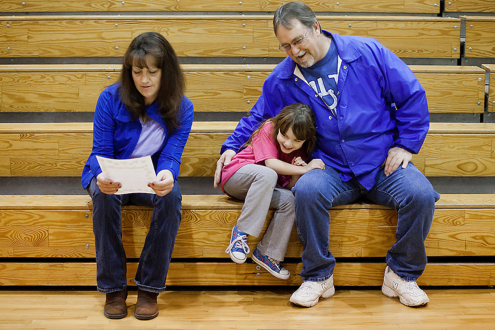 Kiera jumped into Dale's arms while her mother, Tara, looked over a flyer from the dance rehearsal they were picking her up from at Huntingburg Elementary School on Jan. 31. Tara said she is grateful that Dale became Kiera's legal guardian as she couldn't be there for her while going through drug court.