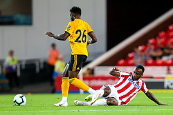 Saido Berahino of Stoke City tackles Bright Enobakhare of Wolverhampton Wanderers - Mandatory by-line: Robbie Stephenson/JMP - 25/07/2018 - FOOTBALL - Bet365 Stadium - Stoke-on-Trent, England - Stoke City v Wolverhampton Wanderers - Pre-season friendly