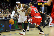 Apr 19, 2010; Cleveland, OH, USA; Cleveland Cavaliers forward LeBron James (23) tries to drive past Chicago Bulls forward James Johnson (16) during the first period in game two in the first round of the 2010 NBA playoffs at Quicken Loans Arena. Mandatory Credit: Jason Miller-US PRESSWIRE
