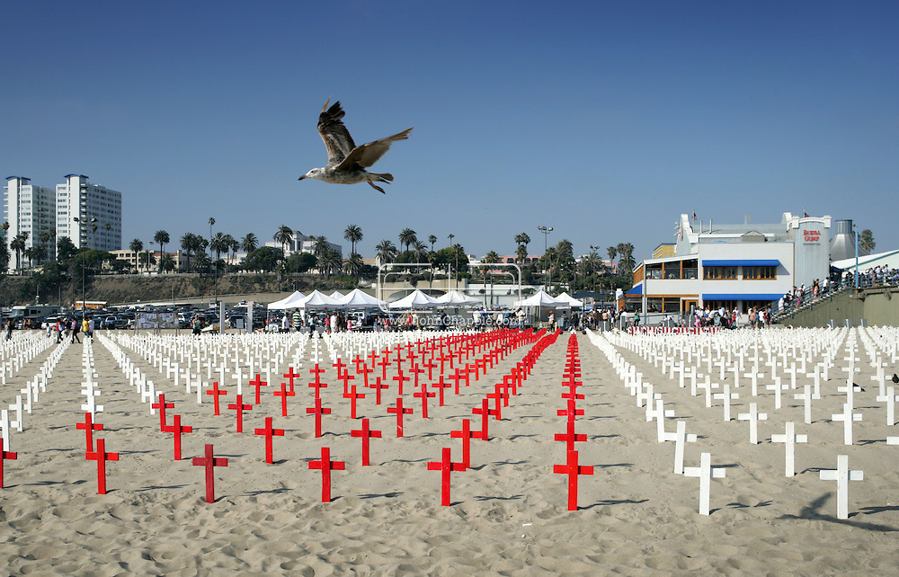 8th June 2008, Santa Monica, California. Every Sunday on the crowded beach at Santa Monica, California, thousands of white crosses are erected as a war memorial. Each cross at the Arlington West Memorial represents the death of a member of the U.S. Armed Forces in Iraq. There are now over 4000 crosses. Since the U.S. invasion of March 2003, the number of Iraqi deaths is over 1 million. PHOTO © JOHN CHAPPLE / REBEL IMAGES.tel: +1-310-570-9100