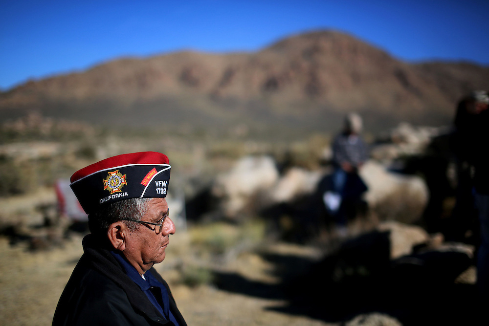 A Veteran stands during an unveiling ceremony for the Mojave Cross on Veterans Day in Cima, California on Sunday, November 11, 2012.  A battle has been brewing for over Thirteen years over whether the cross can legally stay on Sunrise Rock because it violates Separation of Church and State and is in the Mojave National Perserve which is on Federal Lands.  The Veterans of Foreign Wars and American Legion Society raised money to purchase the plot of land and has kept the cross in place and today serves as war memorial.