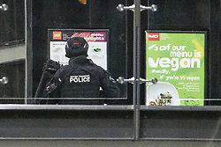 © Licensed to London News Pictures . 14/02/2020. Manchester, UK. Armed British Transport Police are seen in the Arndale Centre during the exercise . Police stage a major terrorist incident as a training exercise , at the Arndale Shopping Centre in Manchester City Centre . Residents have been advised not to be concerned by the sound of loud bangs that might be heard overnight from within the closed-off venue . Photo credit: Joel Goodman/LNP