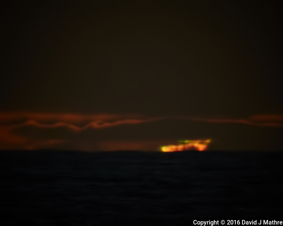 Sun setting over the Pacific Ocean from the deck of the MV World Odyssey. (Glimmer of Green???). Semester at Sea, 2016 Spring Semester Voyage. Day 2 of 102. Image taken with a Nikon 1 V3 camera and 70-300 mm VR lens (ISO 200, 300 mm, f/8, 1/125 sec).