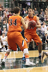 01 March 2014:  Tyler Peter & Nate Haynes during an NCAA mens division 3 CCIW  Championship basketball game between the Wheaton Thunder and the Illinois Wesleyan Titans in Shirk Center, Bloomington IL