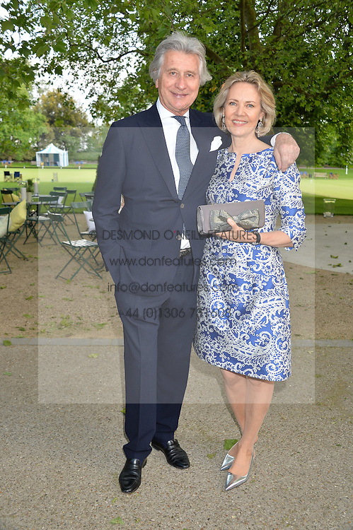 ARNAUD BAMBERGER Executive Chairman of Cartier Ltd and his wife CARLA BAMBERGER at a dinner hosted by Cartier in celebration of The Chelsea Flower Show held at The Hurligham Club, London on 19th May 2014.