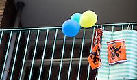 Nederland. Den Haag, 13 september 2006.<br /> Balonnen en een Nederlandse leeuw. Holland. Hollands. Restant op het balken van het wk voetbal, wereldkampioenschap voetbal. Volk, natie, vaderland, vaderlandliefde. oranje, supporter fan voetbalsupporter. driekleur, rood wit blauw.<br /> Foto Martijn Beekman<br /> NIET VOOR TROUW, AD, TELEGRAAF, NRC EN HET PAROOL
